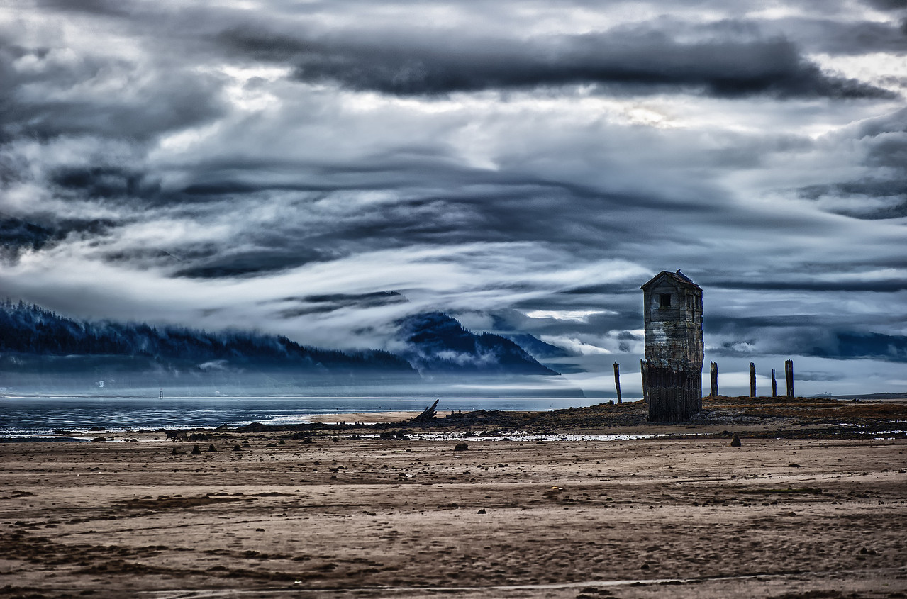 A 7 EV HDR Photograph of Sandy Beach on Douglas Island Alaska looking South.  Remnants of the Historic Treadwell Gold Mine are visible & low clouds hover above the Gastineau Channel.  Taken with a Nikon d700, edited in HDR Efex Pro & Lightroom.