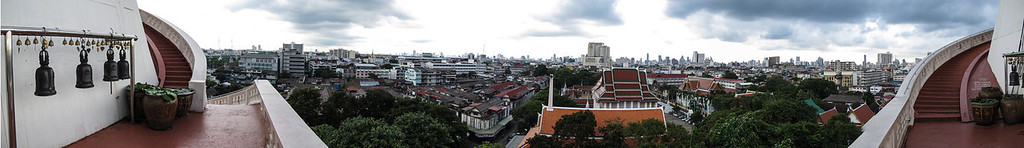 Panoramic Photo taken in Bangkok Thailand on a Temple (Wat) looking over the city.  Taken with a Canon g12 (in camera panorama mode), edited in Photoshop CS5 & Lightroom.