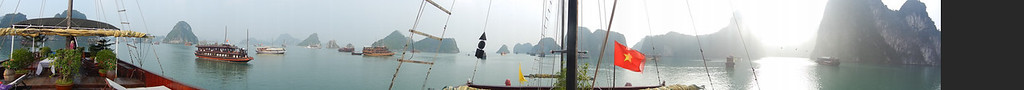 Panorama shot aboard the Poseidon in Ha Long Bay Vietnam.  Shot with a Nikon Coolpix S9100 pano setting, edited with Lightroom & Photoshop CS5.