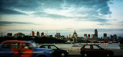 Panorama in London England overlooking the Thames River, shot with an Olympus P&S (time stamped) & scanned with an Epson V300.  Edited in Lightroom & Photoshop CS5.
