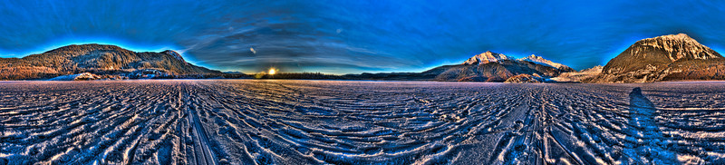 360 degree Panorama taken on a Frozen Mendenhall Lake just before sunset with the Mendenhall Glacier on the right side of the photo near Juneau Alaska, taken with a Sony Alpha a300 on a Nodal Ninja Head.  Edited on PT GUI, Photoshop CS5 & Topaz Adjust.